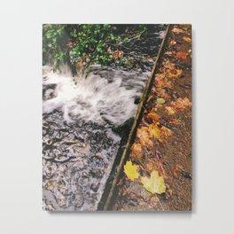 Water flowing through weir covered in autumnal leaves. Norfolk, UK. Metal Print
