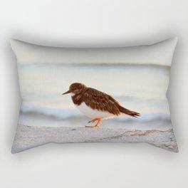 Sandpiper bird enjoying some relaxing time by the sea Rectangular Pillow