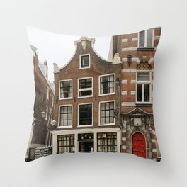 Small snowy typical Amsterdam house in The Netherlands | Red door and dutch architecture | Travel cityscape photography | Fine art print Throw Pillow