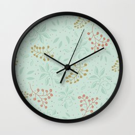 Leaves and fruits pattern in a green background Wall Clock