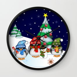 Three little penguins having a Christmas party Wall Clock