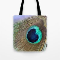 peacock feather Tote Bags featuring Peacock feather by Hannah