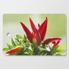 Chili peppers on the vine Cutting Board