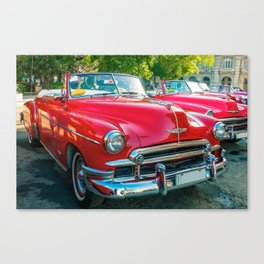 Beautiful red vintage taxis in Havana, Cuba. Canvas Print