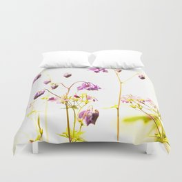 Purple Columbine By The Wall Duvet Cover