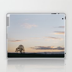 Tree on a hilltop above Matlock silhouetted at twilight. Derbyshire, UK. Laptop & iPad Skin