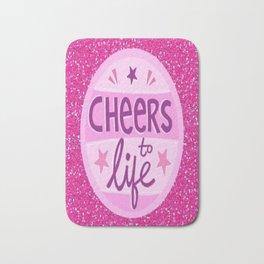 pink glitter cheers to life Bath Mat