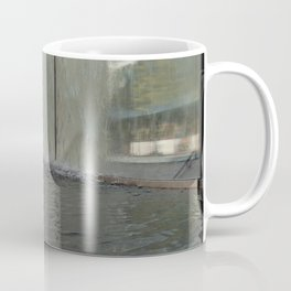 Modern fountain with water splashes on a huge glass window Coffee Mug