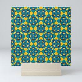Simple geometric boat helm in blue and yellow Mini Art Print