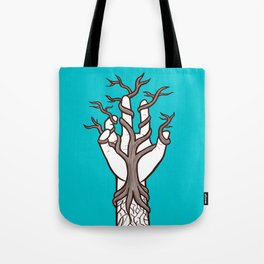 Bare tree growing within a hand – interlacing of nature and humanity Tote Bag
