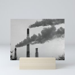 Smoking chimneys in a black and white world Mini Art Print