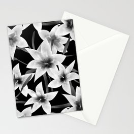 White lilies on a black background . Stationery Cards
