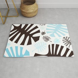 Black and blue tropical leaves Rug