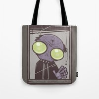 the office Tote Bags featuring Office Zombie by John Schwegel