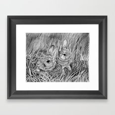 Kit playing with Mother Framed Art Print