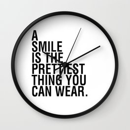 A smile is the prettiest thing you can wear Wall Clock