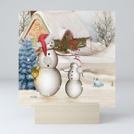 Funny snowmans with christmas hat Mini Art Print