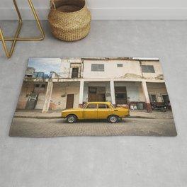 Bright yellow vintage car in La Havana, Cuba. Rug