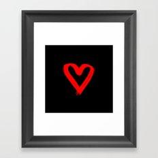 Red heart on black Framed Art Print