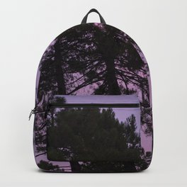 Moon through the trees. Into the woods at sunset Backpack