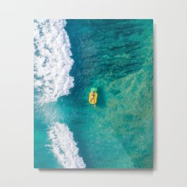 Soak It Up. Woman relaxing on inflatable pineapple in the ocean Metal Print
