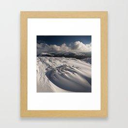 Snow swirls Framed Art Print