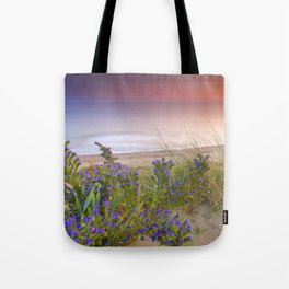 """""""Purple flowers at the sea sunset"""" Tote Bag"""