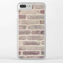 Wall built with bricks of various earth tones Clear iPhone Case