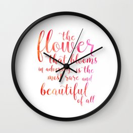 a flower that blooms in adversity is the most rare and beautiful of all Wall Clock