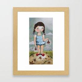 Suzie Saves Starfish by the Seashore Framed Art Print