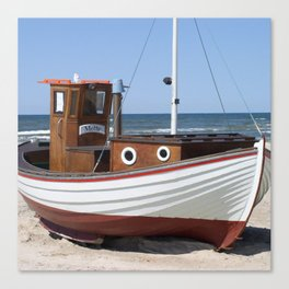 Wooden fishing boat on the beach. Canvas Print