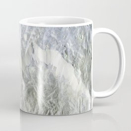 Subtle color differences on Saturns moon Mimas are apparent in this false-color view of Herschel Cra Coffee Mug