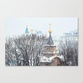 Wooden chapel in winter snowfall Canvas Print