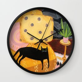 black cat on mustard yellow sofa painting by Tascha Wall Clock