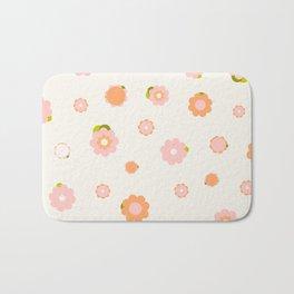Sweet pink and orange flowers over beige Bath Mat
