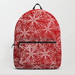 Snowflakes pattern on red background Backpack
