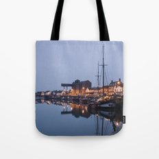 Boats and harbour at dawn twilight. Wells-next-the-sea, Norfolk, UK. Tote Bag