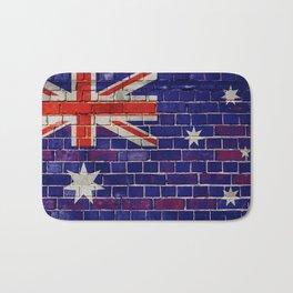 Australia flag on a brick wall Bath Mat