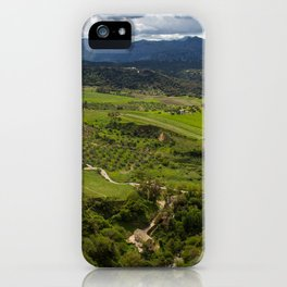 Cliffs in the city of Ronda, Spain. View of the field covered with clouds. iPhone Case