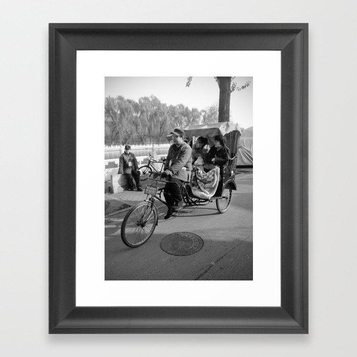 Beijing rickshaw driver in Houhai Framed Art Print