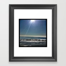 Sun over the waves. Framed Art Print