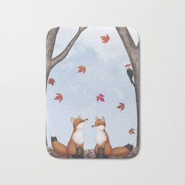 foxes, falling leaves, & pileated woodpecker Bath Mat