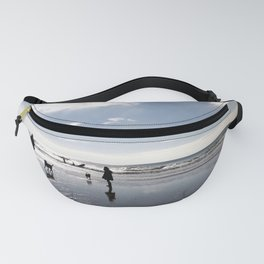 Dog walking on Caswell beach, Swansea in winter Fanny Pack