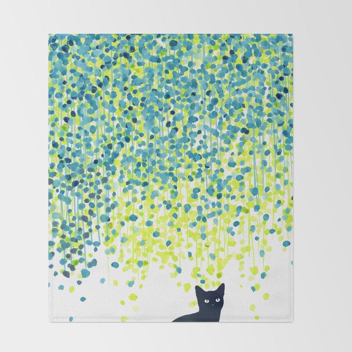 Cat in the garden under willow tree Throw Blanket