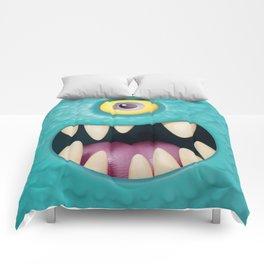 Cartoony monster face Comforters