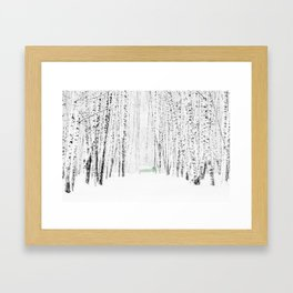 Green bench in white winter forest Framed Art Print