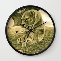 hunting Wall Clocks featuring Hunting Lioness  by Design Windmill