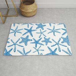 Sea stars in blue Rug