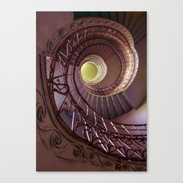 Spiral staircase in red and golden tones Canvas Print