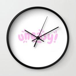 Uneasy - Pastel Pink Splash Typographic Wall Clock
